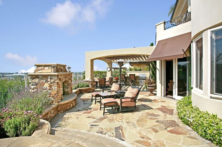 Southwestern Patio with Outdoor kitchen, exterior stone floors, outdoor pizza oven