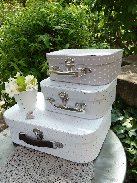 Decoupage old suitcases for this cute home look.