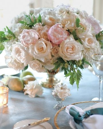 Romantic centerpieces of roses and peonies complement delicate, gold-rimmed table settings