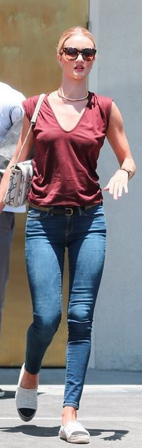 Who made Rosie Huntington-Whiteley's gold jewelry, watch, flat shoes, blue skinny jeans, and brown handbag?