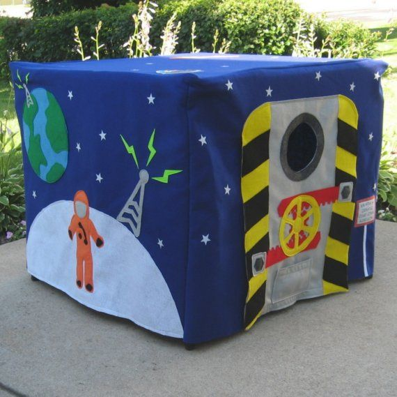 """this etsy shop has way cool card table playhouses. i LOVE this """"outer space"""" one, but she also has construction, pirate, train, and many many more themes."""