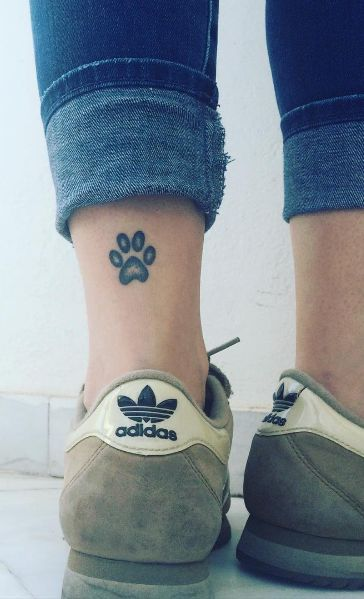 Paw print ankle tattoo                                                       …