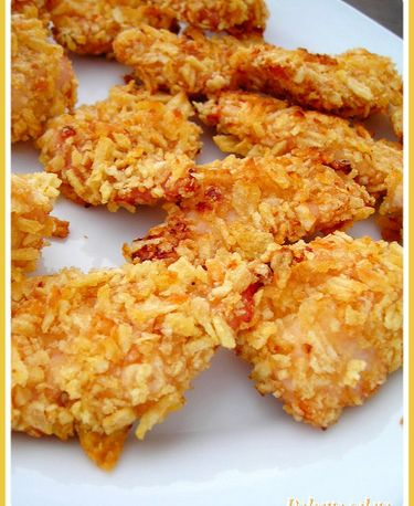 """""""Il pollo con tutte le penne che ha, l'avete mai visto scrivere?"""" [Guido Sperandio] Ingredienti: 3 petti di pollo 4 tbsp (cucchiai) yogurt naturale magro 100 g corn flakes 40 g pangrattato 40 g sem..."""