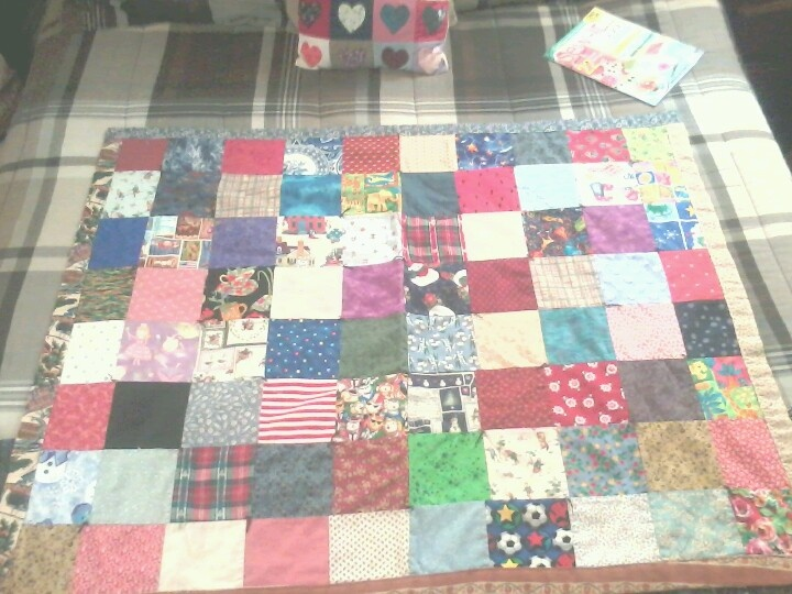 A lovely lap or child's patchwork quilt