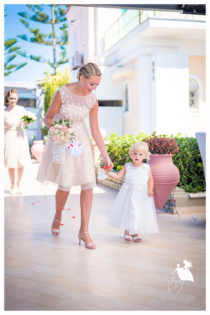 Beautiful bridesmaid with the lovey flower girl!