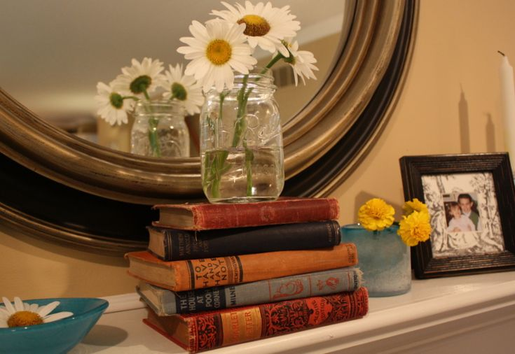 Informal look - round mirror, old books, flowers in jam jar (hooked on houses)