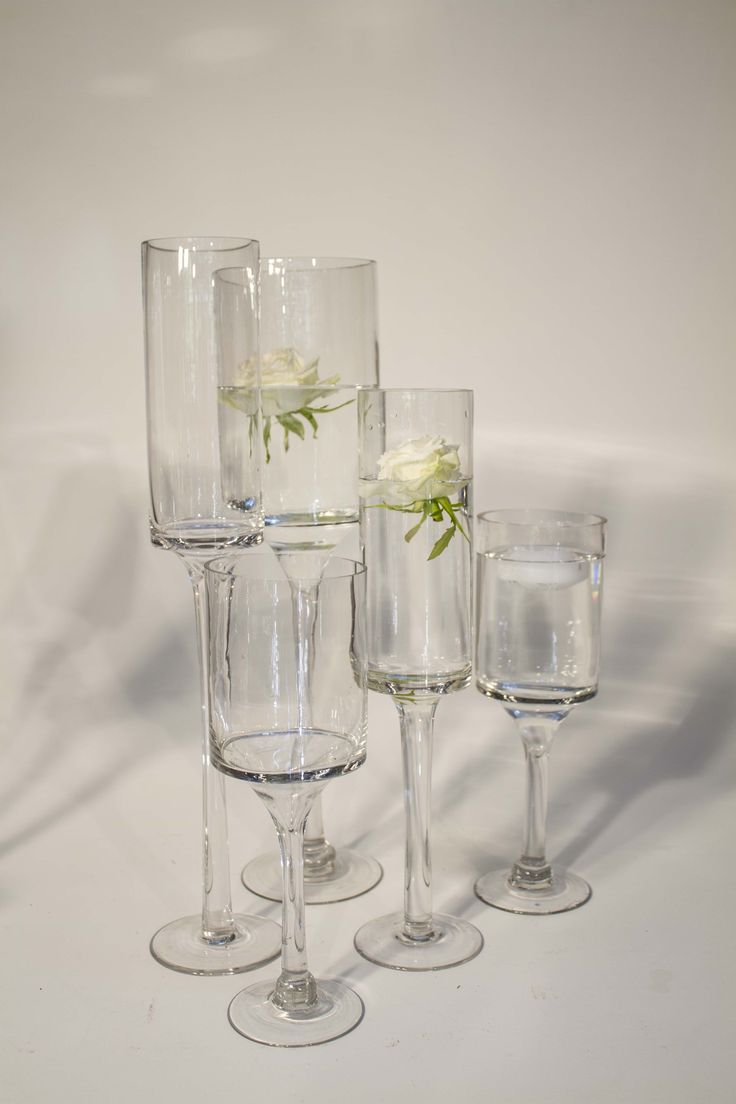Stemmed glass vases in various sizes for hire.