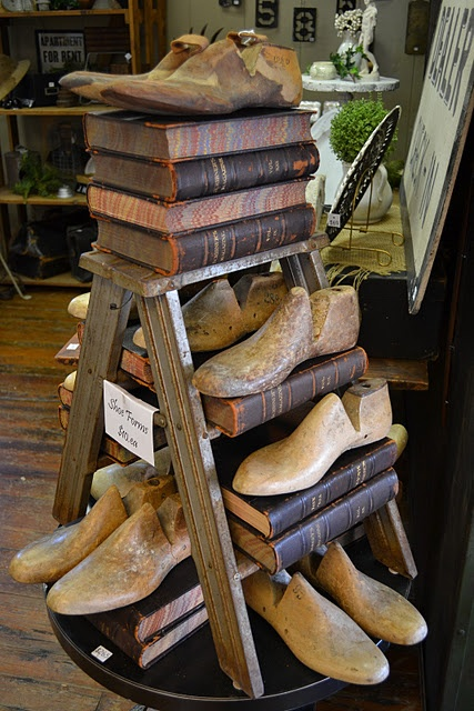 Fabulous vintage cobblers shoe lasts and old books as a display Repinned by www.silver-and-grey.com