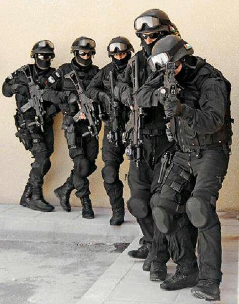 Swat team strapped up; one day I will be apart of this team. A team I've dreamed of for so long.