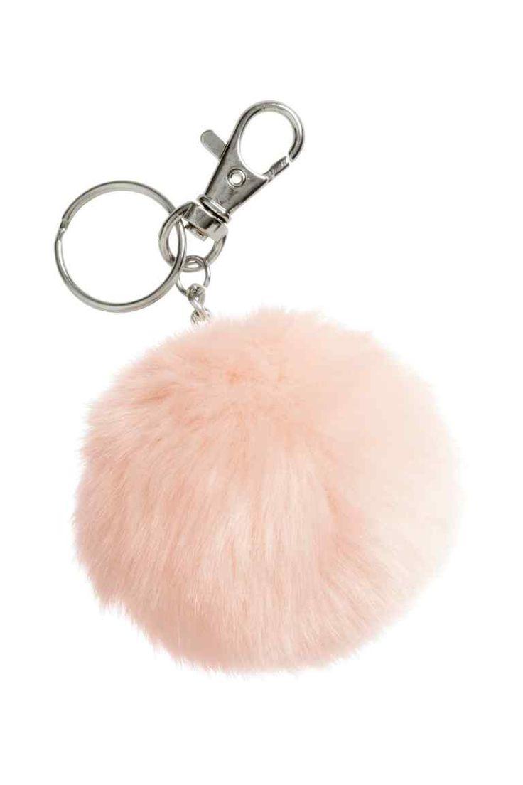 Porta-chaves: Porta-chaves em metal com fecho mosquetão e um pompom em pelo sintético. Comprimento: 12 cm.