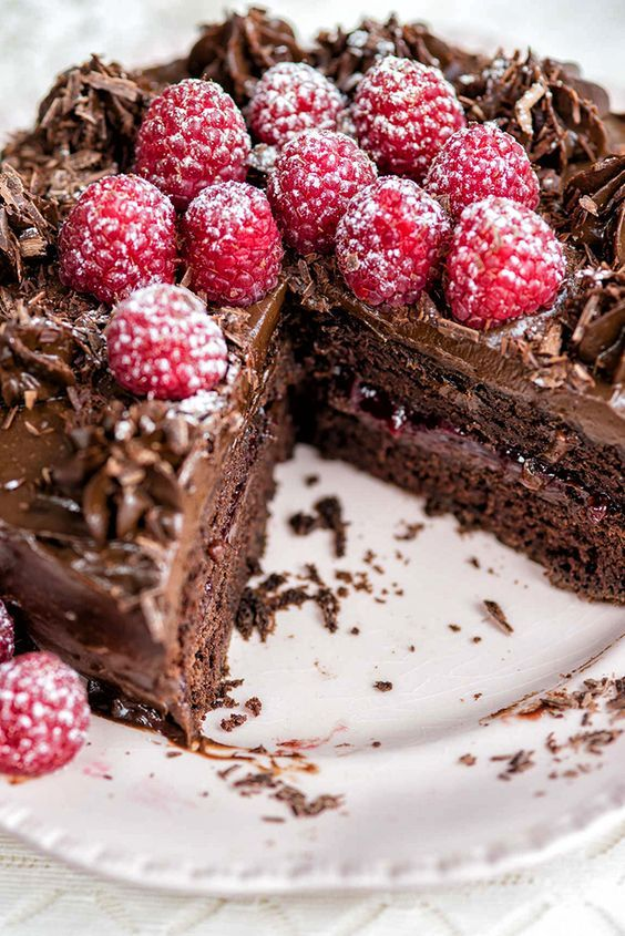 Super-fudgy vegan chocolate cake with avocado frosting and fresh raspberries | Supergolden Bakes
