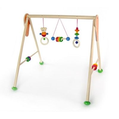 Beautifully made wooden baby gym.  The approximate dimensions of the assembled gym are 62cm (width) x 57 cm (depth) x 55 cm (height - this is the measurement to the highest point of the gym).  The top bar can be adjusted to 3 different heights.  Delivered unassembled.  Age 0+