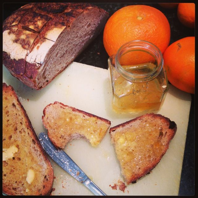 Homemade Seville Orange Marmalade, made from homegrown Seville Oranges, on homemade Sourdough Bread.