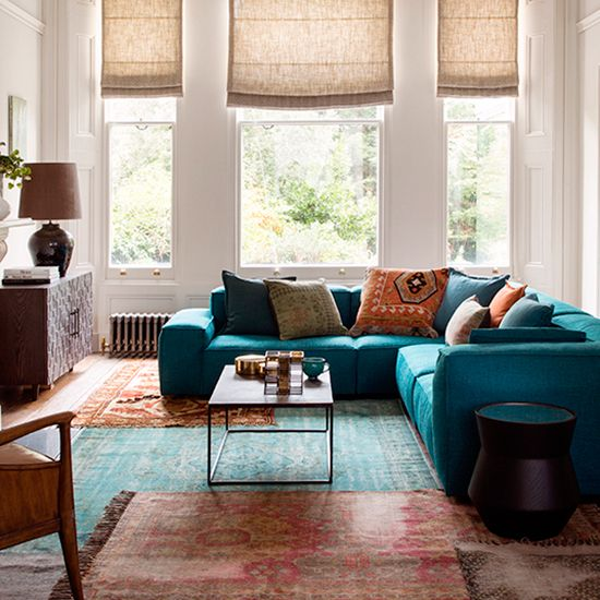 Overlapping rugs to create a playful patchwork look is a great way to introduce striking colour combinations without overpowering the room. Homes & Gardens. Styling Claudia Bryant, photograph Paul Raeside. http://www.hglivingbeautifully.com/2016/01/07/clever-design-ideas-decorating-with-rugs/