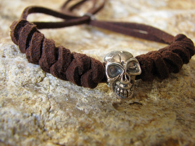 Sterling silver skull in brown leather, $20