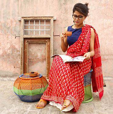 Red bagru print cotton saree and indigo blouse