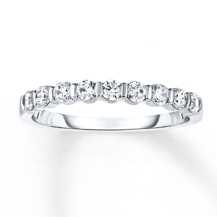 Channel-set round diamonds form a brilliant row in this lovely anniversary band for her. The ring has a total diamond weight of 1/2 carat. Diamond Total Carat Weight may range from .45 - .57 carats.
