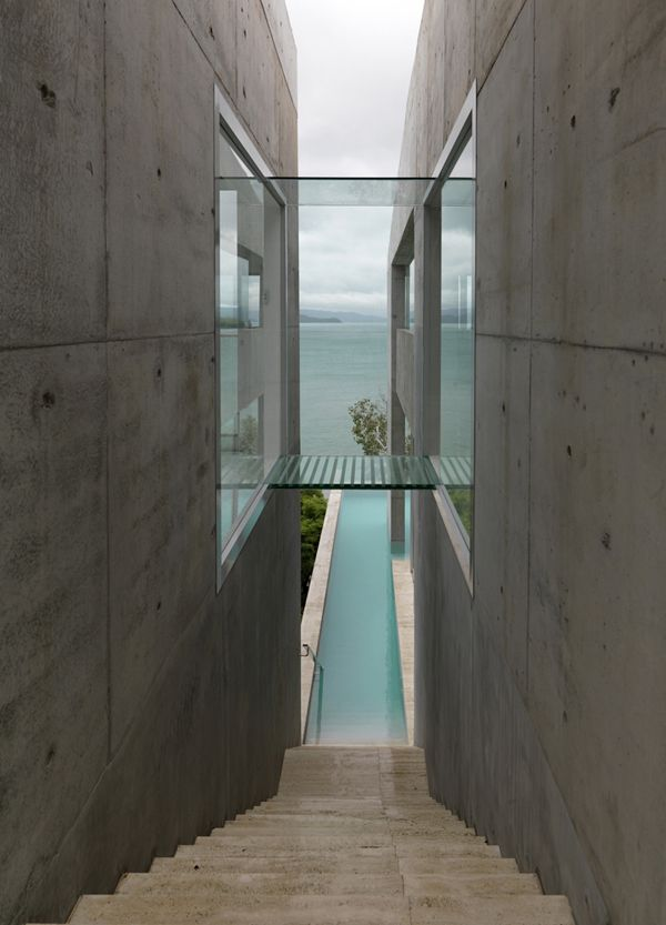 Breathtaking Solis Residence clinging cliffside on Hamilton Island. Designed by Renato D'Ettorre Architects