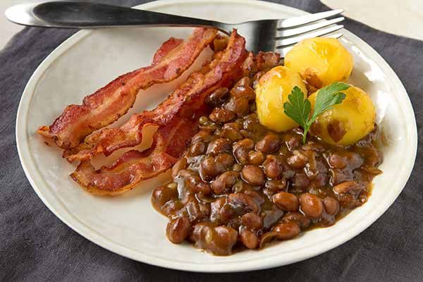 Swedish Baked Brown Beans (Bruna Bönor)  This flavorful baked bean recipe is an excellent example of the traditional Swedish dish Bruna Bönor, a sweetened bean dish typically served on Shrove Tuesday with smoked pork or Swedish potato sausage.
