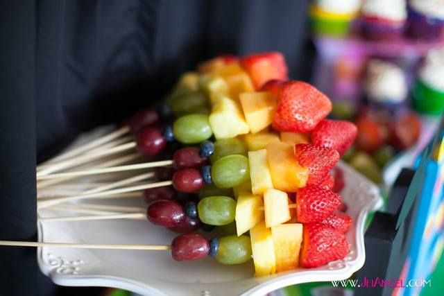 Rainbow fruit skewers at a Mickey Mouse Clubhouse Party.  See more party ideas at CatchMyParty.com!  #mickeymouse #minniemouse