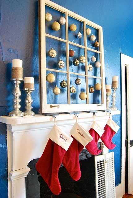 "Loving This Mantle! I really like the old window with hanging ornaments in each ""pane"". Also digging the jute wrapped candles and silver 