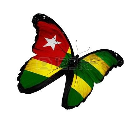Togo flag butterfly flying isolated on white background Stock Photo