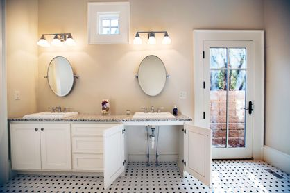 Love the fact that someone in a wheelchair can roll under the sink and that the mirrors look adjustable to taller and shorter folks. If you put those cabinet doors on sliders so they can open and slide back underneath the sink, it would be more functional.