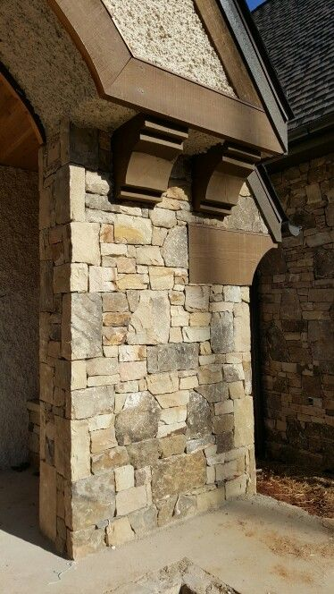 Stone and cedar corbels with a little pebble dash luxury custom home asheville builder home builder