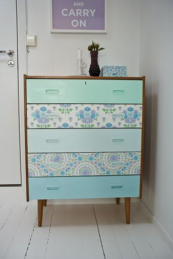 Chest of drawers- alternate painted drawers with drawers covered in paper.