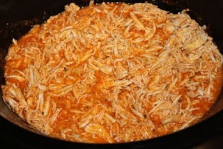 Crock Pot Buffalo Chicken...frozen chicken breasts, Franks and a dry ranch dressing packet.  Easy!