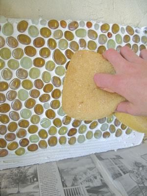 Glass Tile Backsplash  Here's a method for creating an incredibly easy backsplash in your restroom or kitchen!  Learn more at The Mother Earth News