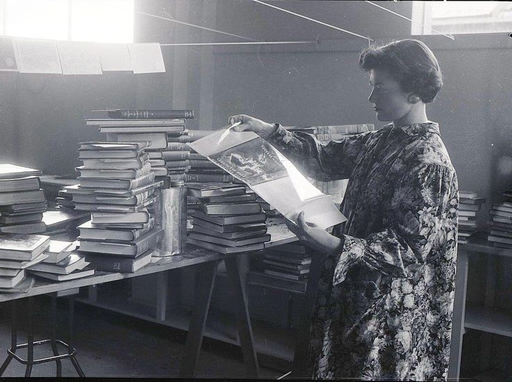 Judy Nicholas prepares books to be included in the Orange City Library collection. 1956 Image from the Central Western Daily Collection, Orange and District Historical Society.