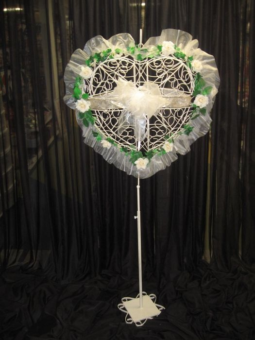 Heart Money Box on Floor Stand. The Heart Money box on floor is a beautiful decor item as well as a money box.  This rental stands 6 feet tall.