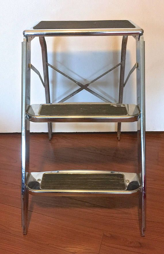 For local pick up only: a vintage, Beautyware chrome, folding metal step stool. Good vintage condition with some tarnishing, a bit of rust, paint splatters, and some loss of rubber on steps (see photos). Measures 22 high x 14 wide x 20.5 deep when extended. Folds flat. Local pick up