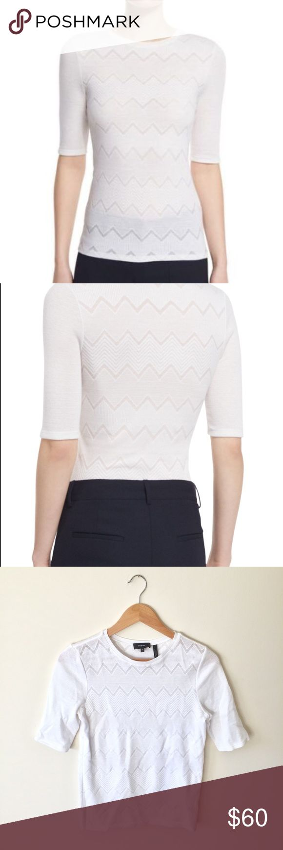 Theory | White Santea C Terrace Chevron Top | M Theory | White Santea C Terrace Chevron Top | Size M  -Size: M -Condition: Excellent used condition! -Color: white -Style: chevron print short sleeve knit -Measurements: 23 inches in length, 12.5 inch sleeve  -Material: cotton/nylon/spandex (dry clean) -Closure: pullover -Pair with: your favorite wife leg trousers and pumps for work! Theory Tops Tees - Short Sleeve