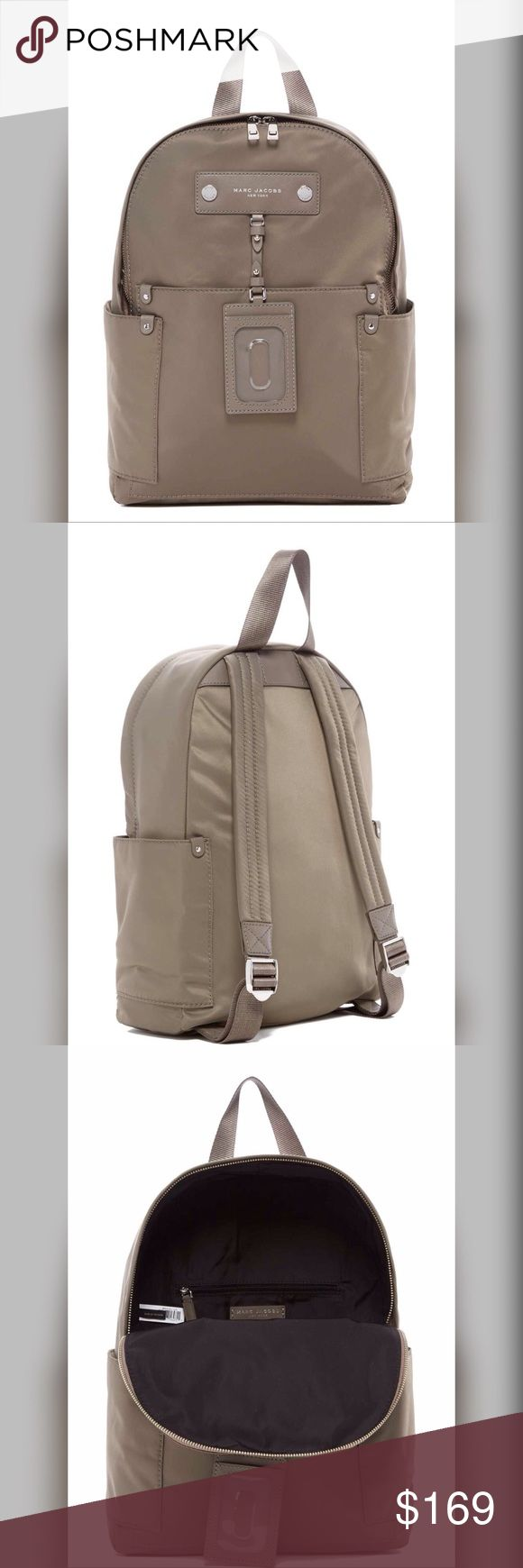 """Marc Jacobs Preppy Nylon Backpack Brand New! Marc Jacobs Preppy Nylon Backpack in Quartz Grey color.  Sleek, streamlined designed with comfy channel-stitched shoulder straps and a dangling luggage tag. Refined logo hardware adds understated branding. - Single top handle - Adjustable dual shoulder straps - Zip closure - Exterior features side slip pockets - Interior features zip pocket and slip pockets - Approx 13.5""""H x 15""""W x 4""""D Marc Jacobs Bags Backpacks"""