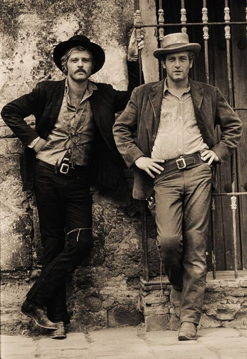 letsenjoyattractivemen:    Robert Redford, Paul Newman.  From Butch Cassidy and the Sundance Kid, photo by Lawrence Schiller.  I'm really enjoying the less-than-perfect aesthetic of the 60s + 70s. Scruffy-looking nerf-herders, indeed!    (via anneyhall)
