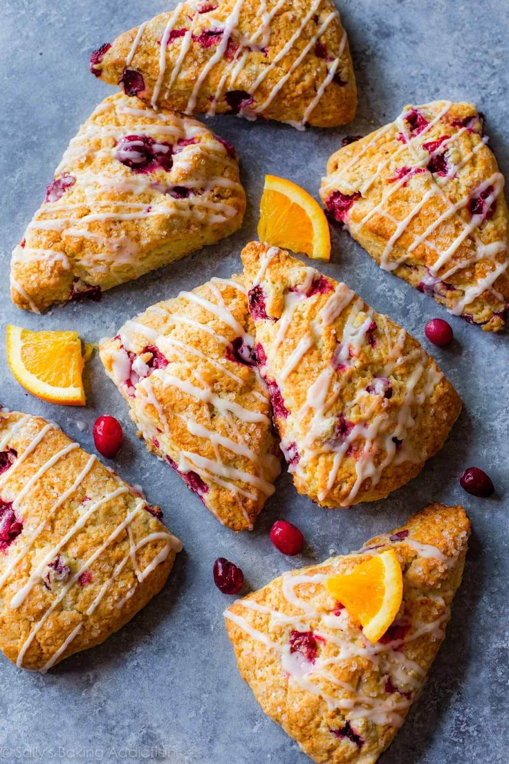 Crumbly edges, bursts of orange flavor, orange glaze, and lots of cranberries make these scones better than any I've tried! sallysbakingaddiction.com