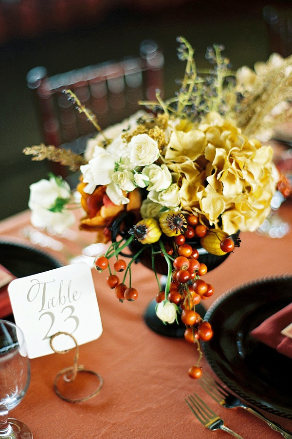 Gorgeous fall centerpiece with pepper berry, quince, hydrangea, rose, & millet