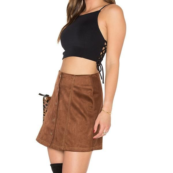 Motel has wowed us again with this sleek, sexy number. Pair your Odette Top with a high waisted skirt or jeans for a cas look. Sexy tied sides show the perfect amount of peekaboo. Also available in red.