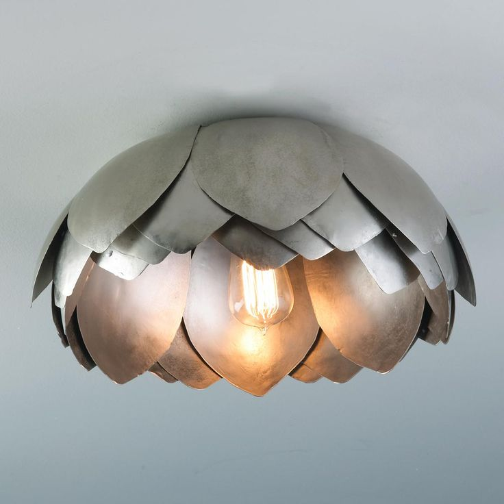 Metal lotus flush mount ceiling light for my living room because my husband knocked down our