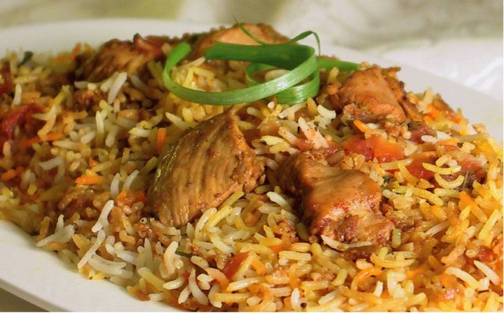 Easy Chicken Biryani recipe. Small pieces of chicken in a creamy, spicy blend of onion, garlic, ginger, turmeric and tomatoes. Posted by Tracey.