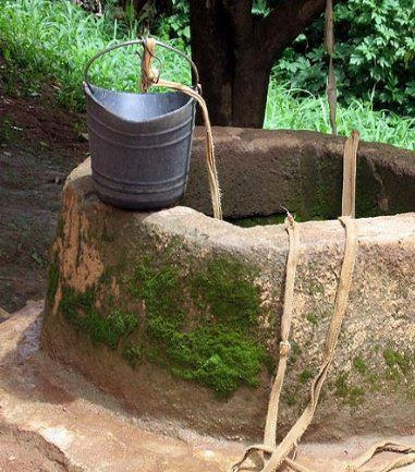 old stone well and bucket