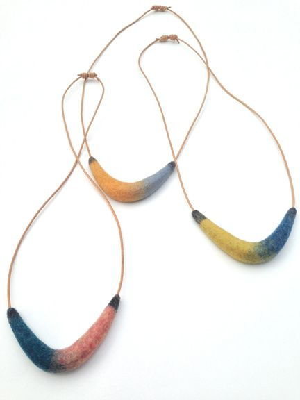Artfully crafted handfelted pillows, wall hangings and jewelry. Modern lines. Ancient technique.