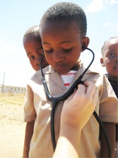 Medical Mission Trip. I love this- getting this child involved and educating him by letting him hear his heartbeat. <3
