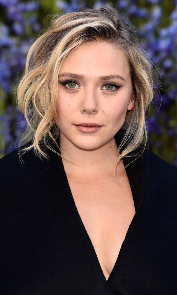 Elizabeth Olsen // beauty, brows, cat-eyeliner, tousled hair and a low cut look #style #fashion #makeup