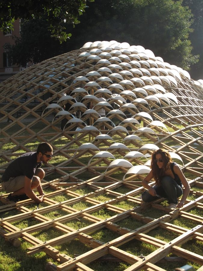 """Grid(h)ome Pavilion """"In Rome, a modular grid forms the shell of a chestnut wood pavilion that can adapt to any space."""" http://www.frameweb.com/news/grid-h-ome-pavilion"""