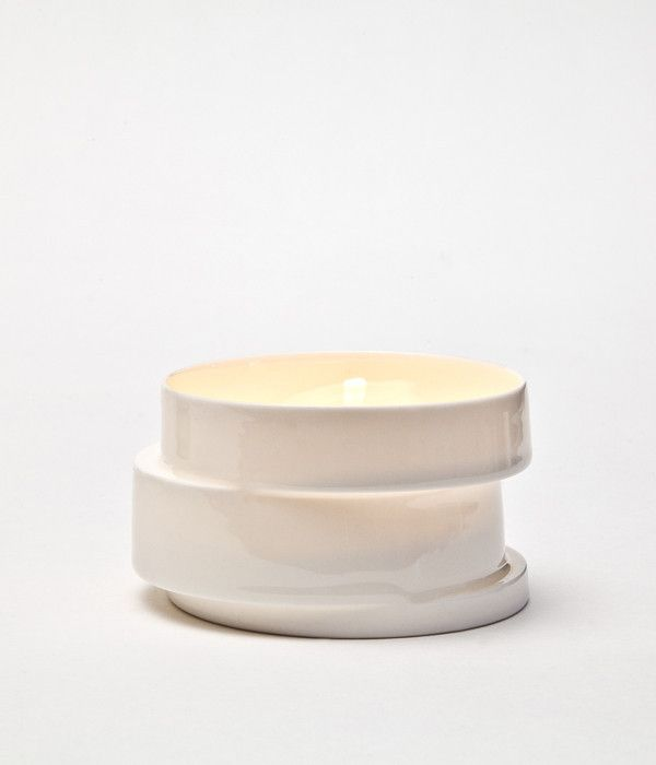 """""""The Stacked Light House"""" is a tealight holder cast in the very transparent Parian porcelain. Each tealight holder consists of three cylindrical rings which are stacked and staggered horizontally relative to each other. All tealight holders are unique because the structure of the rings and the displacement will be different from casting to casting. When lit up """"The Stacked Light House"""" glows in a warm orange colour and the displacements gives beautiful light and shadow effects."""