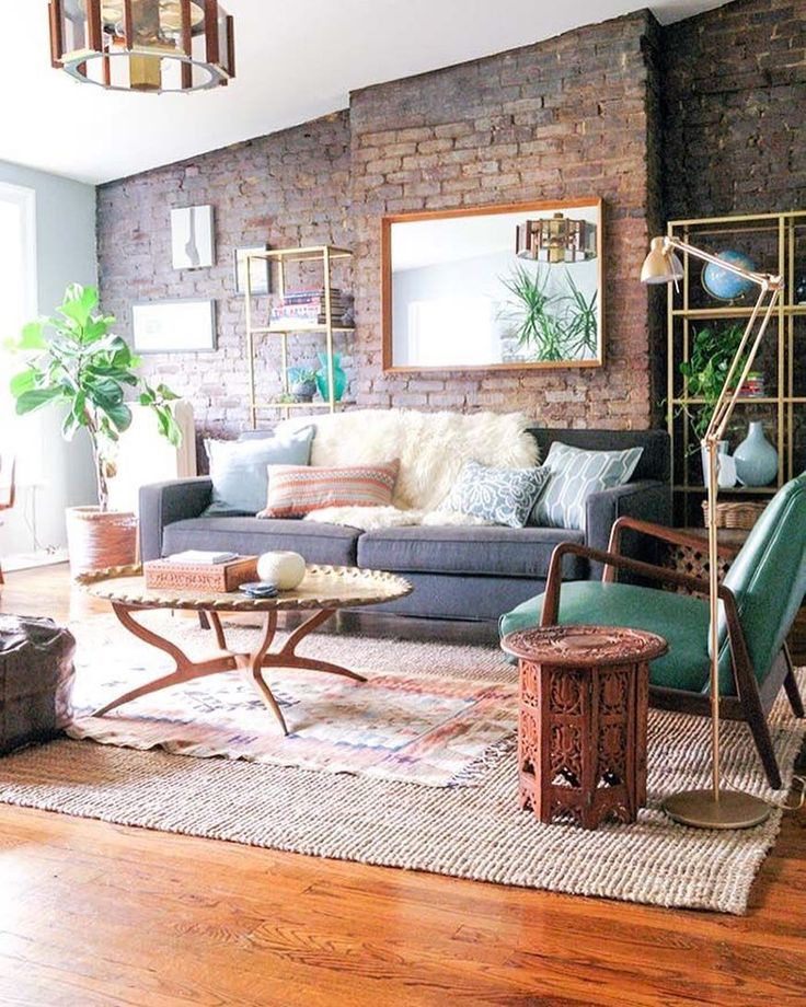 Imagine if that wall was just white - it would feel so bare in comparison. Bricks bring warm interest to this room http://www.VintageBricks.com