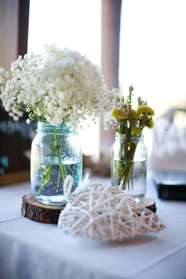 Table decor. We dyed our own mason jars  with glass paint and made our own wood slices.